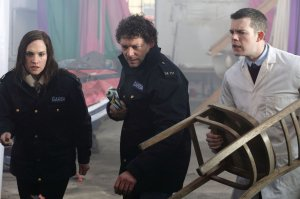 Richard Coyle showing Ruth Bradley and Russell Tovey that a rolled-up newspaper is the preferred weapon