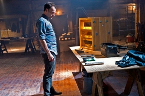 Sherlock (Jonny Lee Miller) wondering which tool to try first