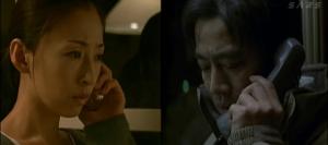 Yasuko Hanaoka (Yasuko Matsuyuki) and Tetsuya Ishigami (Shin'ichi Tsutsumi) secretly confer