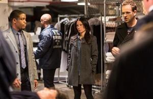 Sherlock (Jonny Lee Miller), Joan (Lucy Liu) and Detective Bell (Jon Michael Hill, left) clean up after the murder