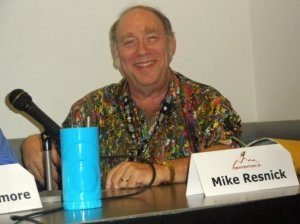 Mike Resnick with his blue mug from Atlantis