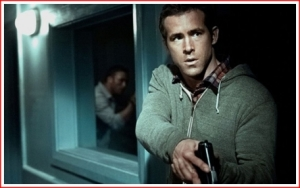 Ryan Reynolds watchful in defence
