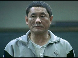 Takeshi Kitano as the teacher whose class is selected