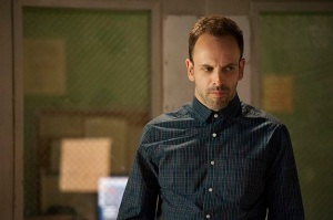 Jonny Lee Miller looking tense