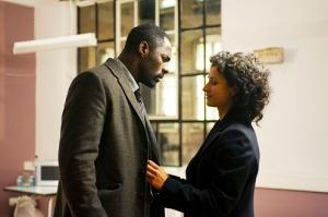 John Luther (IIdris Elba) and Zoe (Indira Varna)