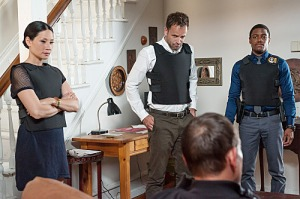 Watson (Lucy Liu), Holmes (Jonny Lee Miller) and Detective Bell (Jon Michael Hill) unnecessarily wearing body armour