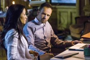 Holmes (Jonny Lee Miller) and Watson (Lucy Liu)