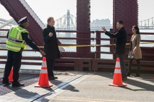 Holmes (Jonny Lee Miller(, Watson (Lucy Liu) and Gregson (Aidan Quinn)