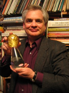David Housewright holding one of his awards