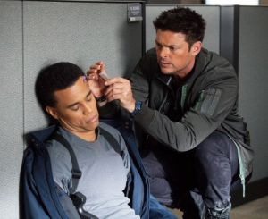 John Kennex (Karl Urban) does brain surgery for dummies on Dorian (Michael Ealy)