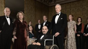 Curtain with Captain Hastings (Hugh Fraser) wheeling Poirot (David Suchet) into action