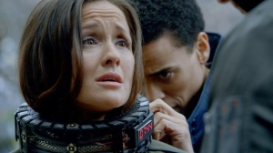 Dorian (Michael Ealy) works to remove the explosive necklace