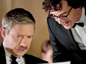 John Watson (Martin Freeman)  is guided on his choice of wine by  Sherlock Holmes (Benedict Cumberbatch)