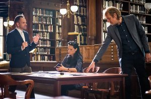 Sherlock (Jonny Lee Miller),  Joan (Lucy Liu) and Mycroft, (Rhys Ifans)