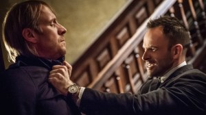 Mycroft Holmes (Rhys Ifans) feeling the love from Sherlock Holmes (Jonny Lee Miller)